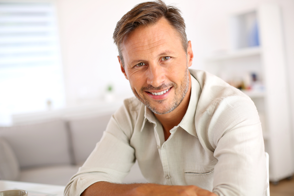 Attractive smiling man relaxing at home